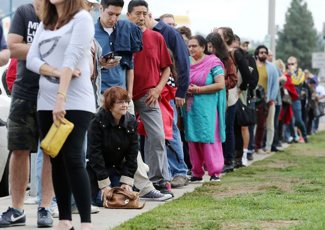 Americans exercising their civic duty and standing in line to cast their vote