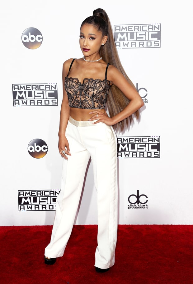 Ariana Grande in a vintage lace bustier and tuxedo pants by Alexander McQueen