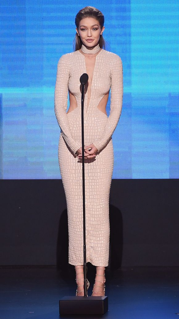 Nude never looked so dressed! Gigi Hadid wears a croc print cut out gown by Julien MacDonald