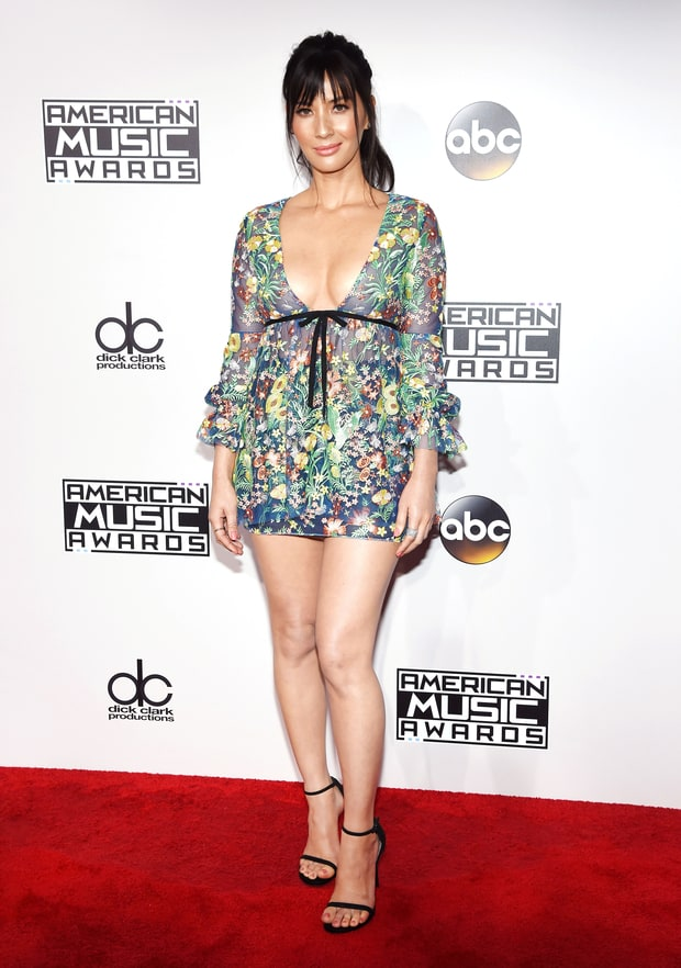 We are confused by Olivia Munn in this Reem Acra mini dress/ skort....we're not sure what or why it is!