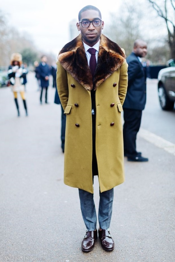 A strong fur collar on an overcoat screams sophistication