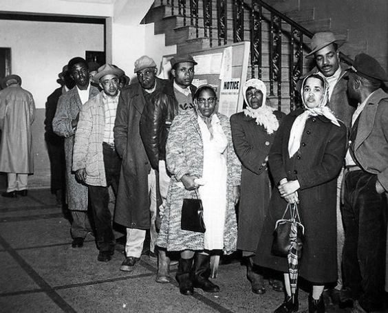 The Voting Rights struggle of Black Sharecroppers in the 1950s and 1960s. | Photo: People waiting in line for hours to register to vote while enduring the taunts of onlookers.