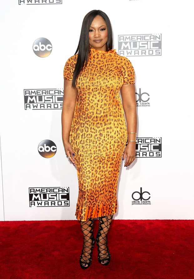 Garcelle beauvais in a printed Masaki Matsuka proved that yellow doesn't always have to be mellow.....this yellow is M-E-O-W!