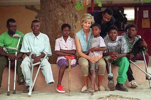 "Prince Harry's mother Princess Diana was affectionoately known as ""The People's Princess"". Here she is seen visiting victims of land mines in Angola Africa"
