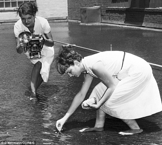 The future first Lady photographs Dale Chestnut feeding goldfish on the roof-