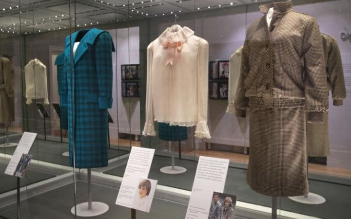 A green and black tartan wool day-suit worn by Princess Diana on a royal visit to Italy in 1985, a pale pink chiffon blouse worn for Diana's first official portrait in 1981 and a brown tweed wool day suit worn on her honeymoon in Balmoral in 1981, on display at the Diana: Her Fashion Story exhibition CREDIT: YUI MOK/PA WIRE