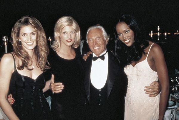 Giorgio Armani with Cindy Crawford, Linda Evangelista and Naomi Campbell.