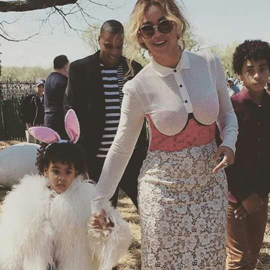 Beyonce, Jay Z, Blue Ivy (wearing a Mongolian lamb jacket from Adrienne Landau) on Easter Sunday 2016