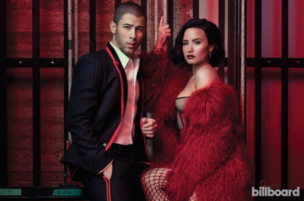 Demi-Lovato-Billboard-Magazine-July-2016-CoverDemi Lovato poses in fuchsia Adrienne Landau stole