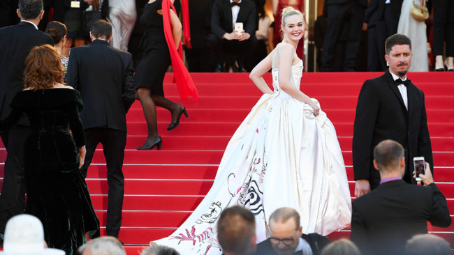Elle Fanning looked like a throwback to Grrace Kelly in her ornate Vivienne Westwood gown at Cannes Film Festival 2017