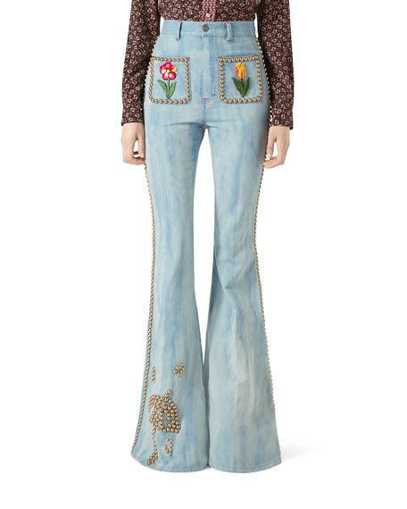 Gucci denim flare-leg pant with studs are a part of their luxury fashion line
