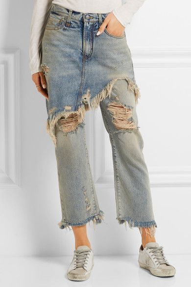 Overly distressed luxury fashion denim