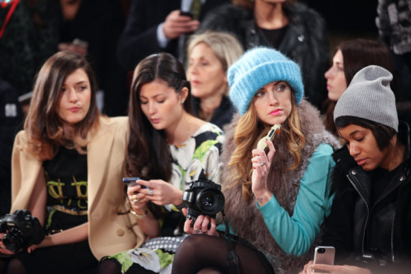 front row luxury fashion influencers during New York Fashion Week