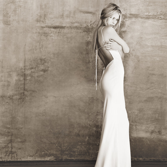 "The very first wedding dress design Monique Lhuillier created the ""Laura"". The dress was simple, stylish, understated and elegant; a big departure from everything else available on the marketplace in the late 1990s"