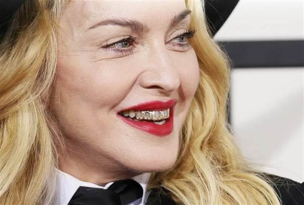 56 year old Madonna rocking a gold grill at the 2015 Grammy Awards. Age Appropriate style