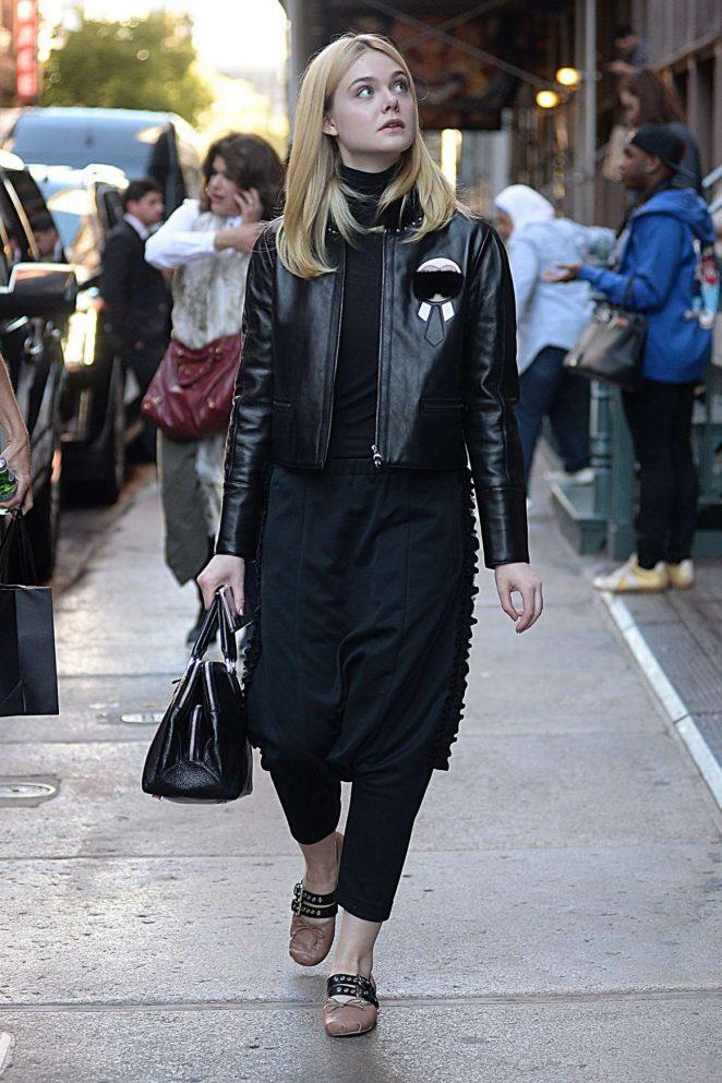 Elle Fanning hits the streets of NYC in a Fendi Karlito black leather jacket and matching with hard-to-pull-off harem pants in age appropriate style