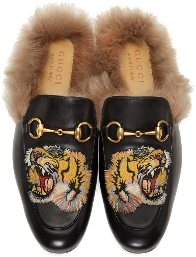 Furry footwear GUCCI Men's Princetown Tiger embroidered leather and lamb fur slippers in black leather
