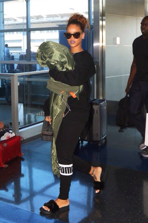 furry footwear Rihanna sporting her Fenty for Puma fur pool slides