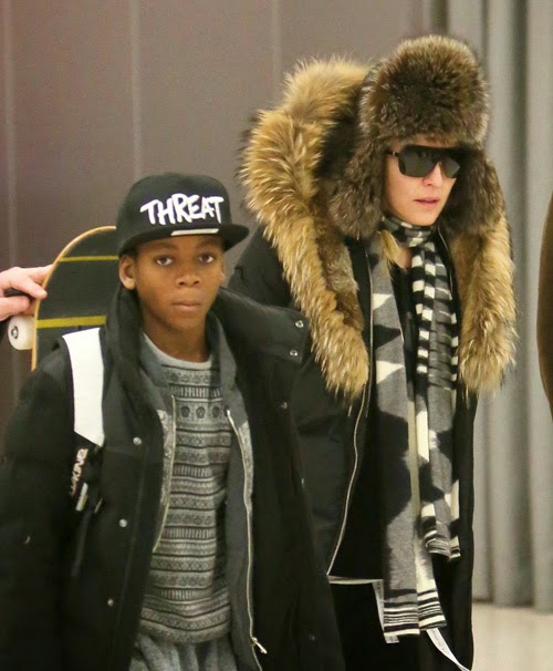 Madonna with her son David making their way through the airport in 2015