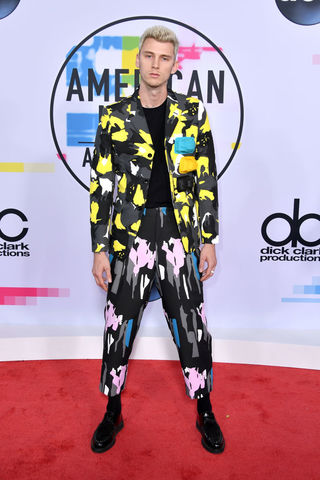Machine Gun Kelly lit it up in his funky and colorful print ensemble