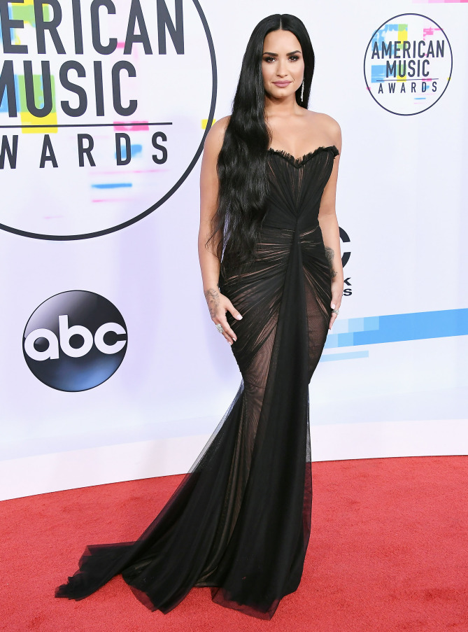 Demi Lovato looking sleek and stealth in a Ester Abner gown
