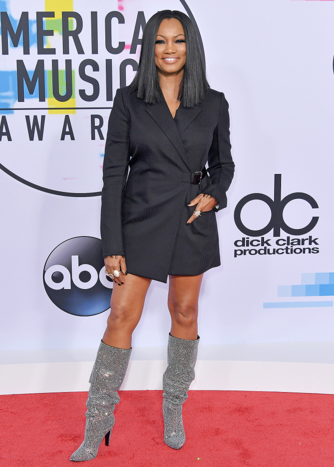 Garcelle Beauvais in her mini tuxedo wrap dress and uber glam Steve Madden boots was a stunner