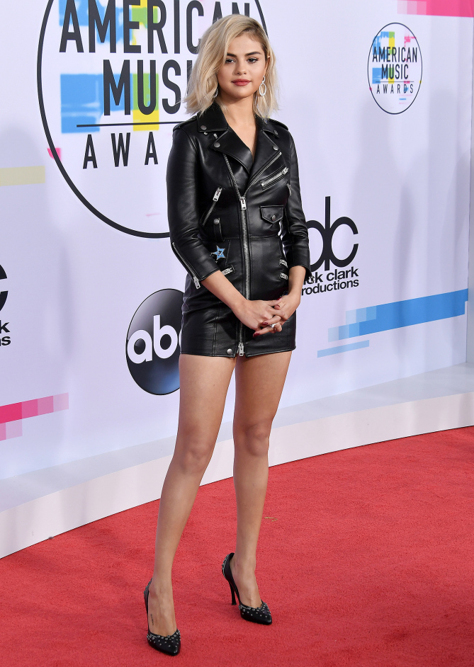 Selena Gomez in a leather trench-style mini dress