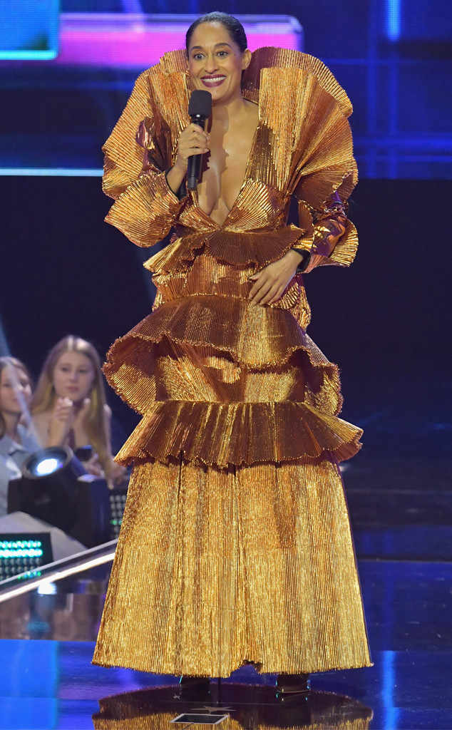 Reporting for duty in her retro vibe bronze lame pleated Roland Van Der Kemp gown. Tracee Ellis Ross AMAs 2017