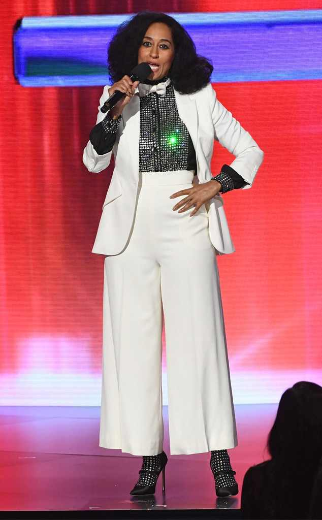 Paying homage to her mamma in a chic Christian Siriano white cropped pants suit