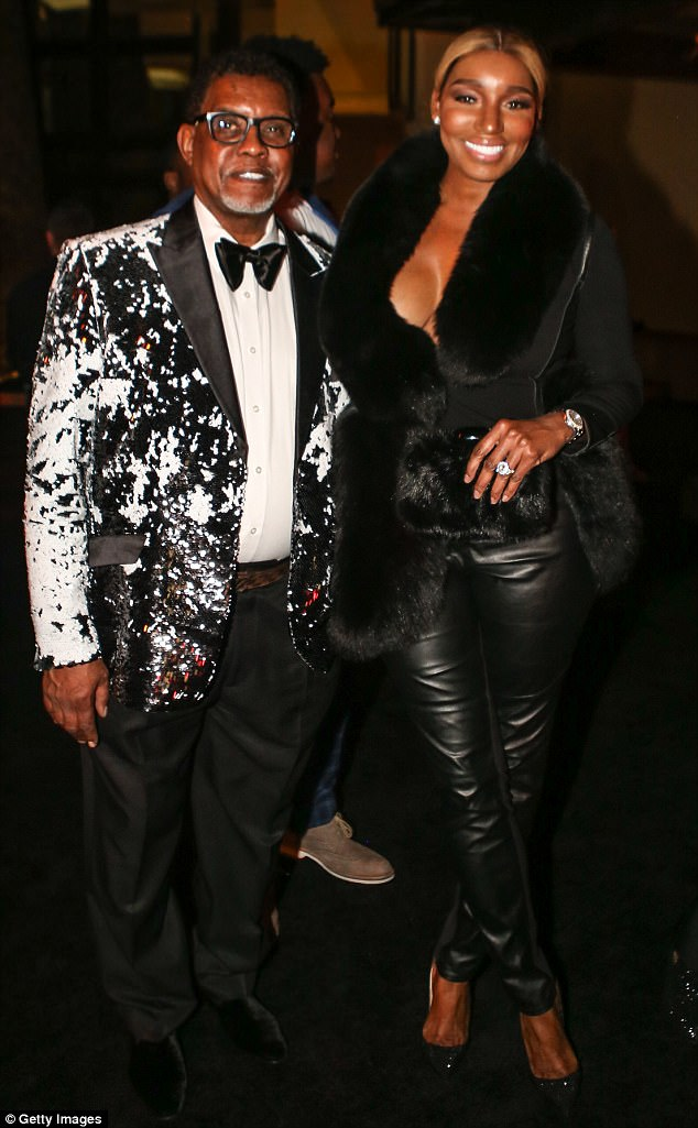 Real Housewives of Atlanta star Nene Leakes rocked a black leather ensemble with matching fur coat, while her and her husband Greg attended Diddy's NYE party celebrity style