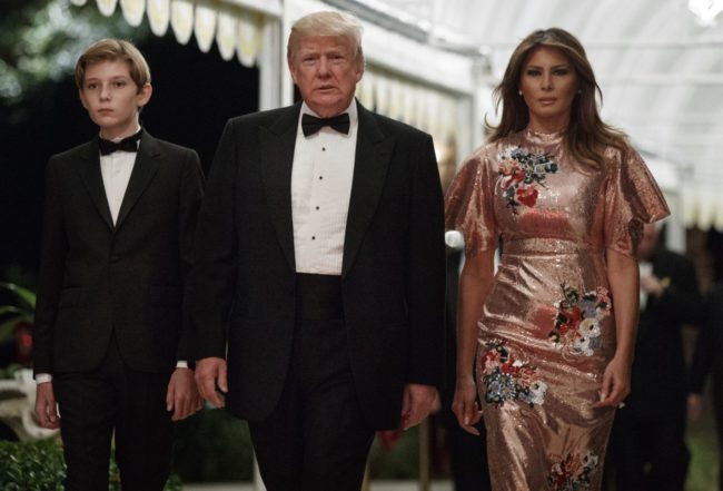 celebrity style President Donald Trump arrives for a New Year's Eve gala at his Mar-a-Lago resort with first lady Melania Trump and their son Barron
