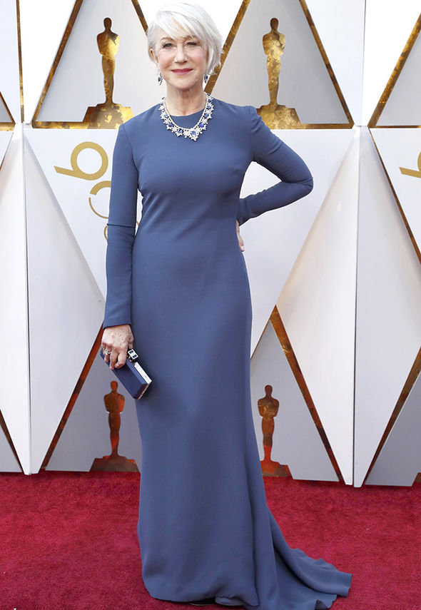 When you look this good you don't need much folks! Helen Mirren, at 72...not a typo, showed off her her hourglass curves in a simple floor-length sheath dress at the 2018 Oscars