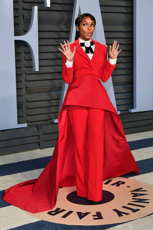 Always a red carpet rogue, singer janelle Monae made a strong statement in her Christian Siriano lipstick red tux with exaggerated train at the 2018 Oscars
