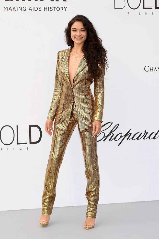 Shanina Shaik came to shine and sparkle in a solid gold Phillip Plein suit at 2018 Cannes Film Festival