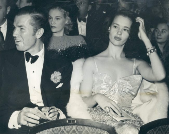 Bruce Cabot and Gloria Vanderbilt attend a theater in Hollywood November 29, 1941