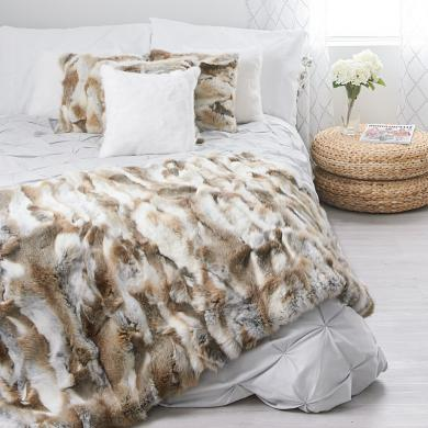 A natural brown rabbit throw and matching pillows from Fur Source create a perfect personalized space for relaxation in home decor