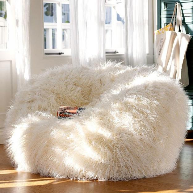 The popular poof silhouette is even more elevated in a natural Mongolian lamb fabrication home decor trends