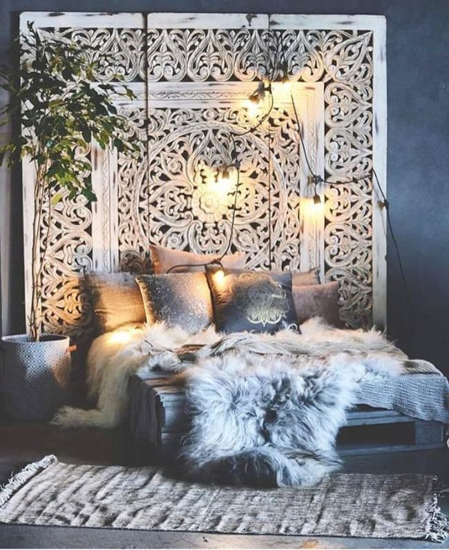 dramatic boho styled bedroom accented with fur throw home decor